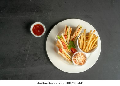 club sandwich top view with french fries
