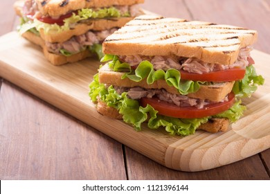 Club sandwich with tuna , tomatoes and lattuce