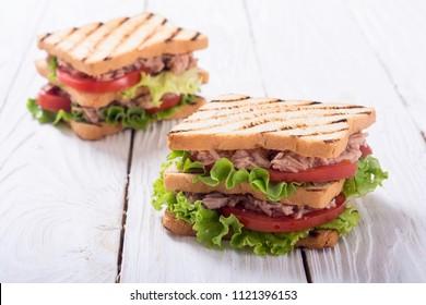Club sandwich with tuna , tomatoes and lattuce