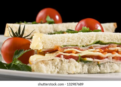Club sandwiches with hard cheese, ham and tomatoes