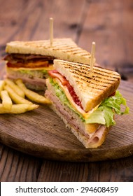 Club sandwiches on the wooden table