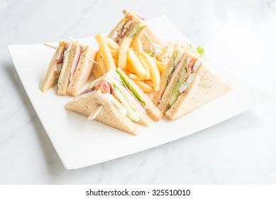 Club sandwiches in white plate - selective focus point
