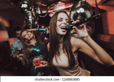 Club. Young People Sing Songs. Great Mood. Karaoke Club. Celebration. Holidays Concept. Dancing People. Smiling Girl. Bar Dancing with Friends. Handsome Men. Beautiful Girls. Have Fun.