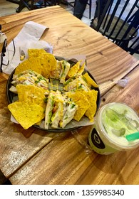 Clubhouse nachos and matcha milktea