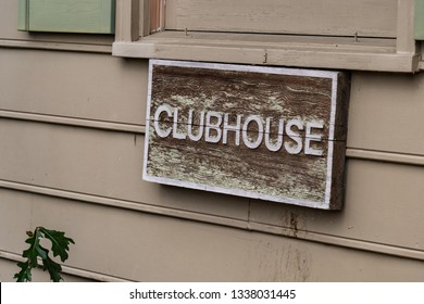 Clubhouse sign on the outside of an apartment building