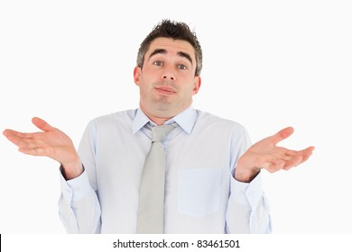 Clueless office worker posing against a white background