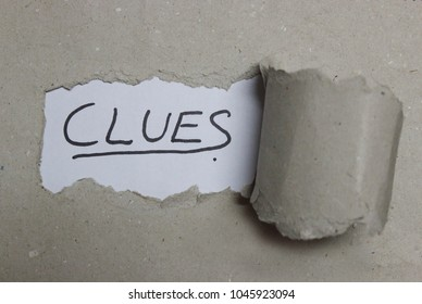 Clues text in torn Paper