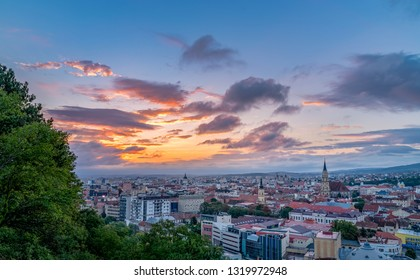 Cluj city overview at sunrise from Cetatuia Hill in Cluj-Napoca, Romania