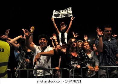 CLUJ - JULY 19: Fans of Camo and Krooked feat MC Youthstar from United Kingdom, partying during a live concert at the Peninsula / Felsziget Music Festival. On July 19, 2013 in Cluj Napoca, Romania