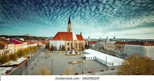 CLUJ NAPOCA, ROMANIA - APRIL 19, 2019: Morning at Medieval St. Michael's Church and Union Square in Cluj-Napoca, Transylvania