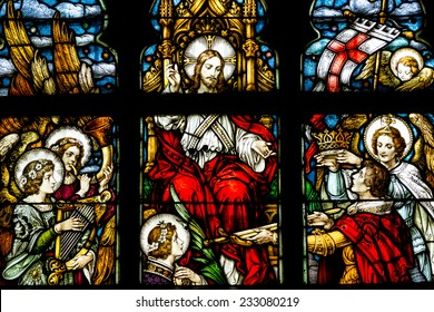CLUJ NAPOCA, ROMANIA - AUGUST 21, 2014: Jesus Christ Resurrection Stained Glass Window Inside The Gothic Roman Catholic Church of Saint Michael Built In 1390.