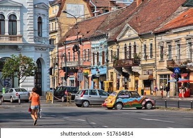 CLUJ NAPOCA, ROMANIA - AUGUST 26, 2012: People visit the Old Town in Cluj-Napoca. Cluj-Napoca is the 2nd most populous city in Romania with 324,576 citizens.