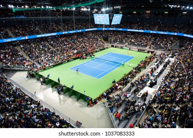 CLUJ NAPOCA, ROMANIA - FEBRUARY 10, 2018: Romania playing tennis against Canada during a Fed Cup match in the Polivalenta Hall indoor court. Crowd of people, fans supporting their team
