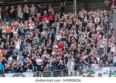 CLUJ NAPOCA, ROMANIA - JULY 12, 2019: Crowd of soccer supporters of U Cluj supporting their favorite football team in the tribune during a match against PAOK Saloniki