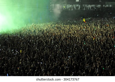 CLUJ NAPOCA, ROMANIA - JULY 31, 2015: Crowd of party people raising their hands during an Avicii live concert at the Untold Festival