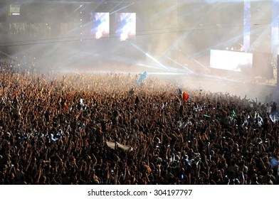 CLUJ NAPOCA, ROMANIA - JULY 31, 2015: Party people having fun during an Avicii live concert at the Untold Festival in the European Youth Capital city of Cluj Napoca