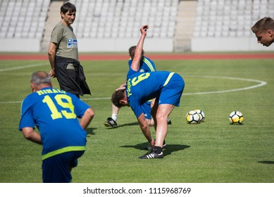 CLUJ NAPOCA, ROMANIA - JUNE 15, 2018: Coach of the Romanian Football Golden Team, Victor Piturca leading his players during training session before a match against Barcelona Legends