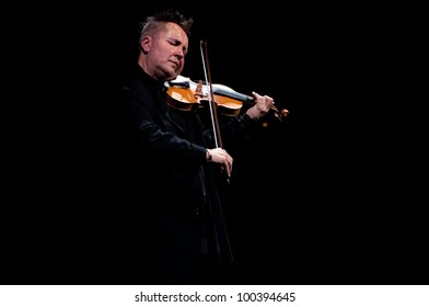CLUJ NAPOCA, CLUJ, ROMANIA - MARCH 03: Nigel Kennedy performs at the National Theathre on March 03, 2012 in Cluj Napoca, Romania.