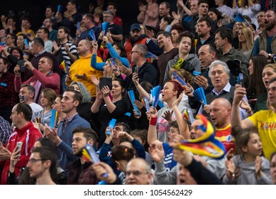 CLUJ NAPOCA, ROMANIA - MARCH 25, 2018: Crowd of people, supporters and sport fans supporting their team at a handball match between Romania and Russia