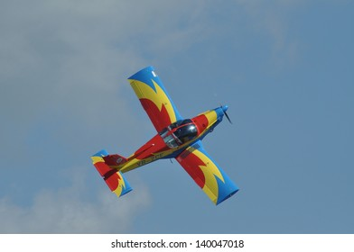 CLUJ NAPOCA, ROMANIA - MAY 18: Extra 300 airplane from Romanian Aeroclub Team and the Romanian Air Force flying on the Romanian Air Fest on May 18, 2013 in Cluj Napoca, Romania