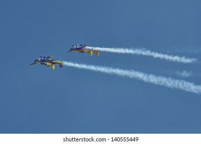 CLUJ NAPOCA, ROMANIA - MAY 18: A group of aircraft in flight smoke color at the Romanian Military Parade on May 18, 2013 in Cluj Napoca, Romania