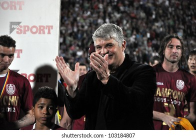 CLUJ NAPOCA, ROMANIA MAY 20: FC CFR Cluj coach, Mr. Ioan Andone celebrating the new league title and the victory against FC Steaua Bucharest, final score 1:1 on MAY 20, 2012 in Cluj N, Romania