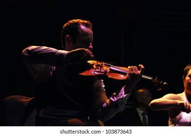 CLUJ NAPOCA, ROMANIA � MAY 29: Nicholas Crosa from Pink Martini pop-jazz band performs live on violin at the Sports Hall of Cluj, Romania, MAY 29, 2012 in Cluj-Napoca, Romania