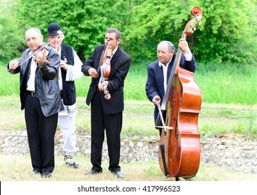 CLUJ NAPOCA, ROMANIA - MAY 8:  Lautarii singing at the Romanian traditional celebration ,Measuring the  sheep.t,  on May 8 2016 in Village museum in Cluj Napoca, Romania.