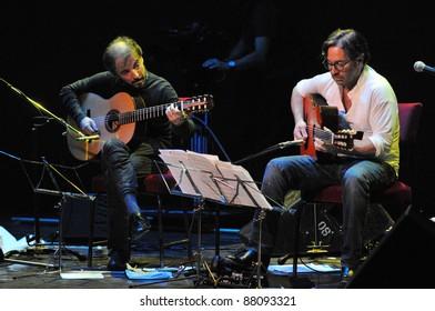 CLUJ NAPOCA, ROMANIA – NOVEMBER 1: Guitarist legend, Al di Meola (R) and Peo Alfonsi (L) perform live at Cluj National Theater of Cluj, Romania, November 1, 2011 in Cluj-Napoca, Romania