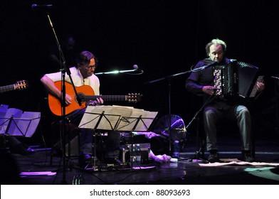 CLUJ NAPOCA, ROMANIA – NOVEMBER 1: Guitarist legend, Al di Meola (L) and Fausto Beccalossi (R) perform live at Cluj National Theater of Cluj, Romania, November 1, 2011 in Cluj-Napoca, Romania