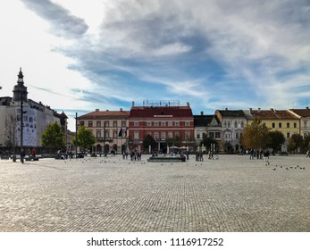 Cluj Napoca, Romania - October 15, 2017: Front view of renovated buildings in the main square of Cluj Napoca, Romania