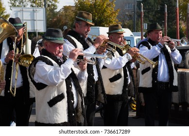 CLUJ NAPOCA, ROMANIA - OCTOBER 15, 2017: A traditional brass-band performing Romanian folk music on wind instruments during the Autumn Fair