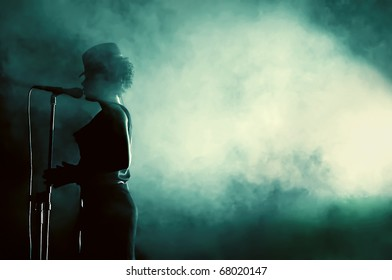 CLUJ NAPOCA, ROMANIA - SEPT. 27: Beate Baumgartner, the female singer of Parov Stelar's band, performs live surrounded by smoke  at Parov Stelar Concert, on September 27, 2009 in Cluj-Napoca, Romania
