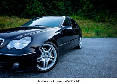 Cluj Napoca/Romania - August 27, 2017: Mercedes Benz C Class, model W203 - year 2004, Avantgarde equipment, AMG Alloy wheels, driver side corner with steered wheels, vented disc brakes, 18 inch alloy