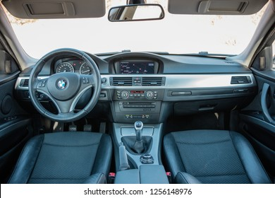 Cluj Napoca/Romania - December 01, 2018. Inside modern luxurious car view - panoramic double sunroof, leather seats, big navigation display dashboard, clean close-up detailed photo.