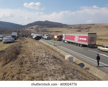Cluj Napoca/Romania - March 09, 2017: Road accident involving two big trucks, as a result of an illegal overtaking, no human victims, only material damages, placed on DN1E60, Unimog and Renault truck