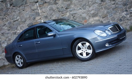 Cluj Napoca/Romania - September 03, 2016: Mercedes Benz W211- year 2004, Avantgarde equipment, blue metallic paint near a rock wall photo session E Class 200 Kompressor, leather interior, luxury car