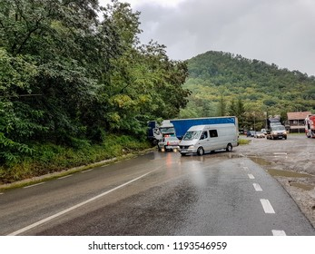 Cluj Napoca/Romania - September 06, 2018: A rainy day and a catastrophic accident between two trucks who skidded and collided in front. No driver has been seriously injured, traffic has been blocked