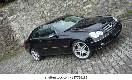 Cluj Napoca/Romania-April 7, 2017: Mercedes Benz W209 Coupe - year 2005, Elegance equipment, Black metallic paint, 19 inch alloy wheels, tinted glass windows, chrome details, 163 Hp engine, right side