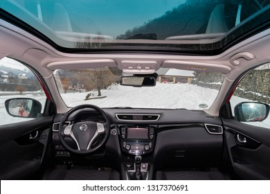 Cluj Napoca/Romania-January 26, 2019: Nissan Qashqai Tekna-year 2015, SUV car photo session. Inside view-glazed black panoramic sunroof, tinted windows, modern cockpit. View from back to front