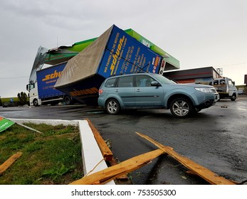 Cluj Napoca/Romania-September 27, 2017:  Big truck with cargo trailer overturned over a all terain jeep. Road accident. No human victims, only vehicle damages. DN1E60