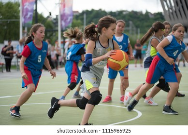 CLUJ, ROMANIA - JUNE 15, 2018: Children playing basketball during the Sports Festival