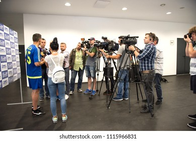 CLUJ, ROMANIA - JUNE 15, 2018: Cameramen, photographers and reporters interviewing football player Constantin Galca before a match against Barcelona Legends