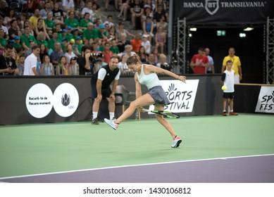 CLUJ, ROMANIA - JUNE 15, 2019: Tennis player legend Simona Halep playing against Daniela Hantuchova during the Sports Festival