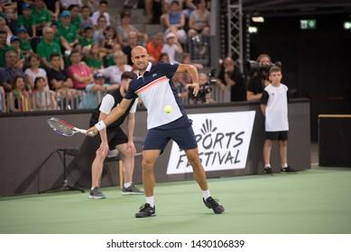CLUJ, ROMANIA - JUNE 15, 2019: Tennis player Marius Copil playing against Fabio Fognini during the Sports Festival