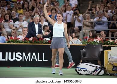 CLUJ, ROMANIA - JUNE 15, 2019: Tennis player legend Simona Halep entering the court at a match against Daniela Hantuchova during the Sports Festival