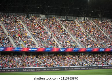 CLUJ, ROMANIA - JUNE 16, 2018: Crowd of people, soccer fans in the tribune supporting their favorites at a match between Romania Golden Team and Barcelona Legends