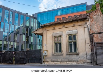 Cluj / Romania - May 30 2020: Gentrification in action old building vs new building