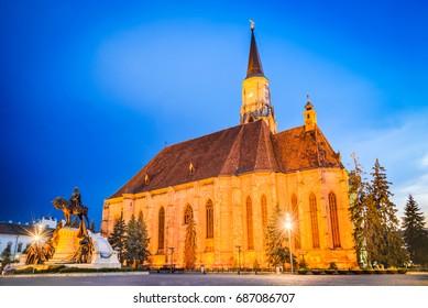 Cluj, Romania. Night scene with St. Michael's Church and Unirii Square in Cluj-Napoca, Transylvania.