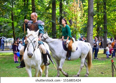 CLUJ, ROMANIA - September 28, 2019:  Horse riding archers demonstrate archery and at equitation skills at an ancient outdoor medieval theme festival .